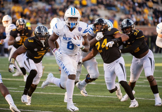 Memphis running back Patrick Taylor Jr. scrambles past Missouri defenders for a touchdown during the second half of the Tigers' loss Saturday.
