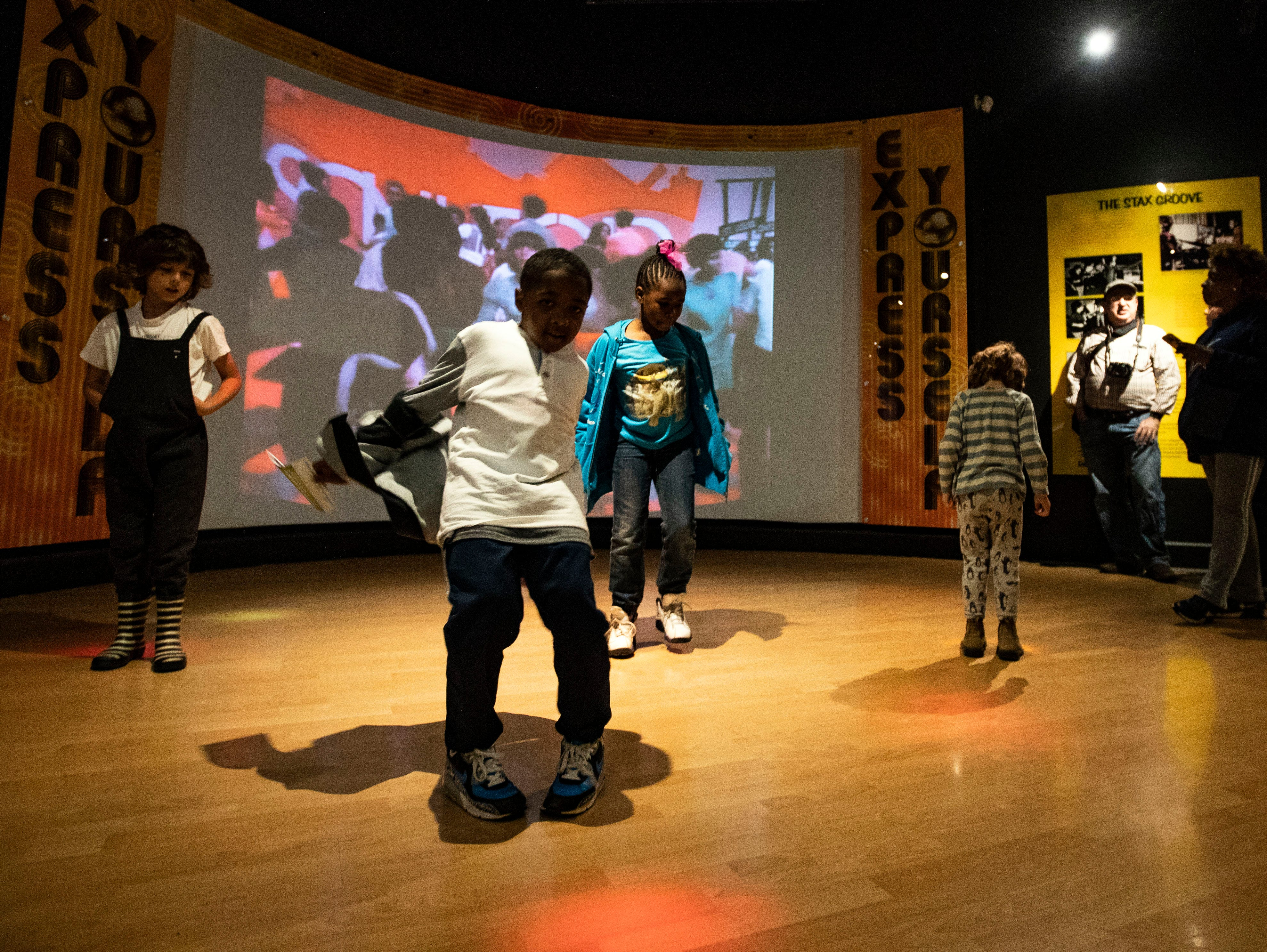 A group of children partake in a dancing game in front of the Soul Train exhibit at the Stax Museum of American Soul Music during the 2018 Soulsville USA Festival Saturday October 20, 2018.