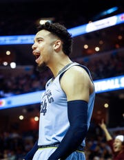 Memphis Grizzlies guard Dillion Brooks celebrates on the bench during action against the Atlanta Hawks in their home-opener at the FedExForum in Memphis, Tenn., Friday, October 19, 2018.