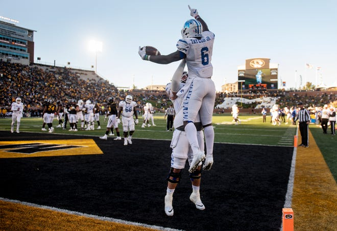 Memphis running back Patrick Taylor Jr., top, celebrates his touchdown with Drew Kyser during the second half of an NCAA college football game against Missouri, Saturday, Oct. 20, 2018, in Columbia, Mo. Missouri won the game 65-33.