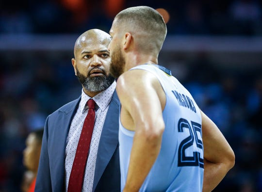 Memphis Grizzlies head coach J.B. Bickerstaff chats with Chandler Parsons during action against the Atlanta Hawks in their home-opener at the FedExForum in Memphis, Tenn., Friday, October 19, 2018.