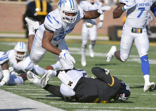 Oct 20, 2018; Columbia, MO, USA; Missouri Tigers wide receiver Jalen Knox (9) runs the ball as Memphis Tigers linebacker Bryce Huff (55) attempts the tackle during the first half at Memorial Stadium/Faurot Field.