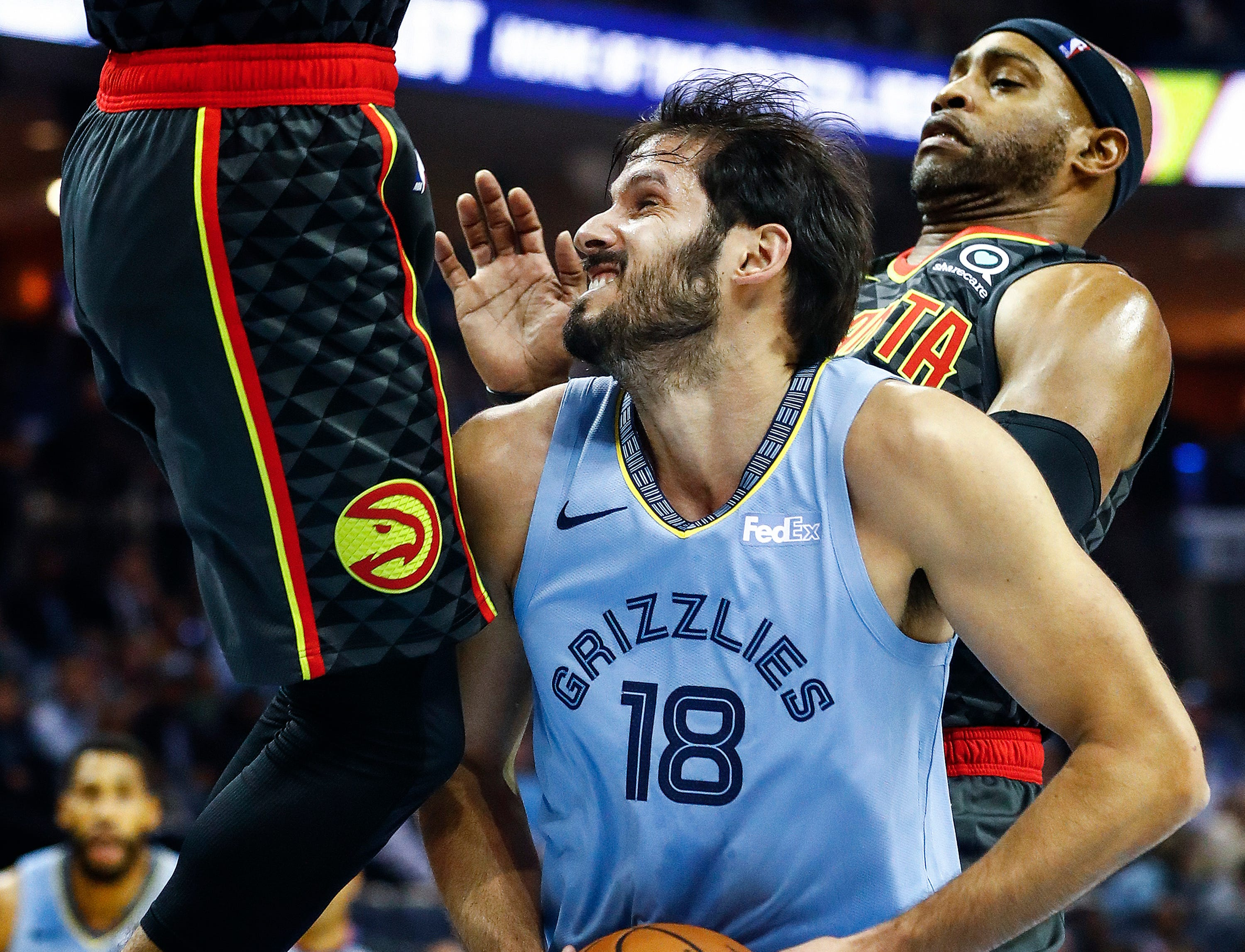 Memphis Grizzlies forward Omri Casspi (middle) drives the lane against the Atlanta Hawks defense in their home-opener at the FedExForum in Memphis, Tenn., Friday, October 19, 2018.