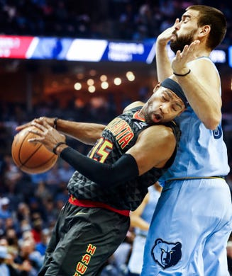 Memphis Grizzlies center Marc Gasol (right) fouls Atlanta Hawks forward Vince Carter (left) during action of their home-opener at the FedExForum in Memphis, Tenn., Friday, October 19, 2018.