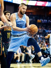Memphis Grizzlies forward Chandler Parsons grabs a rebound against the Atlanta Hawks during action of their home-opener at the FedExForum in Memphis, Tenn., Friday, October 19, 2018.