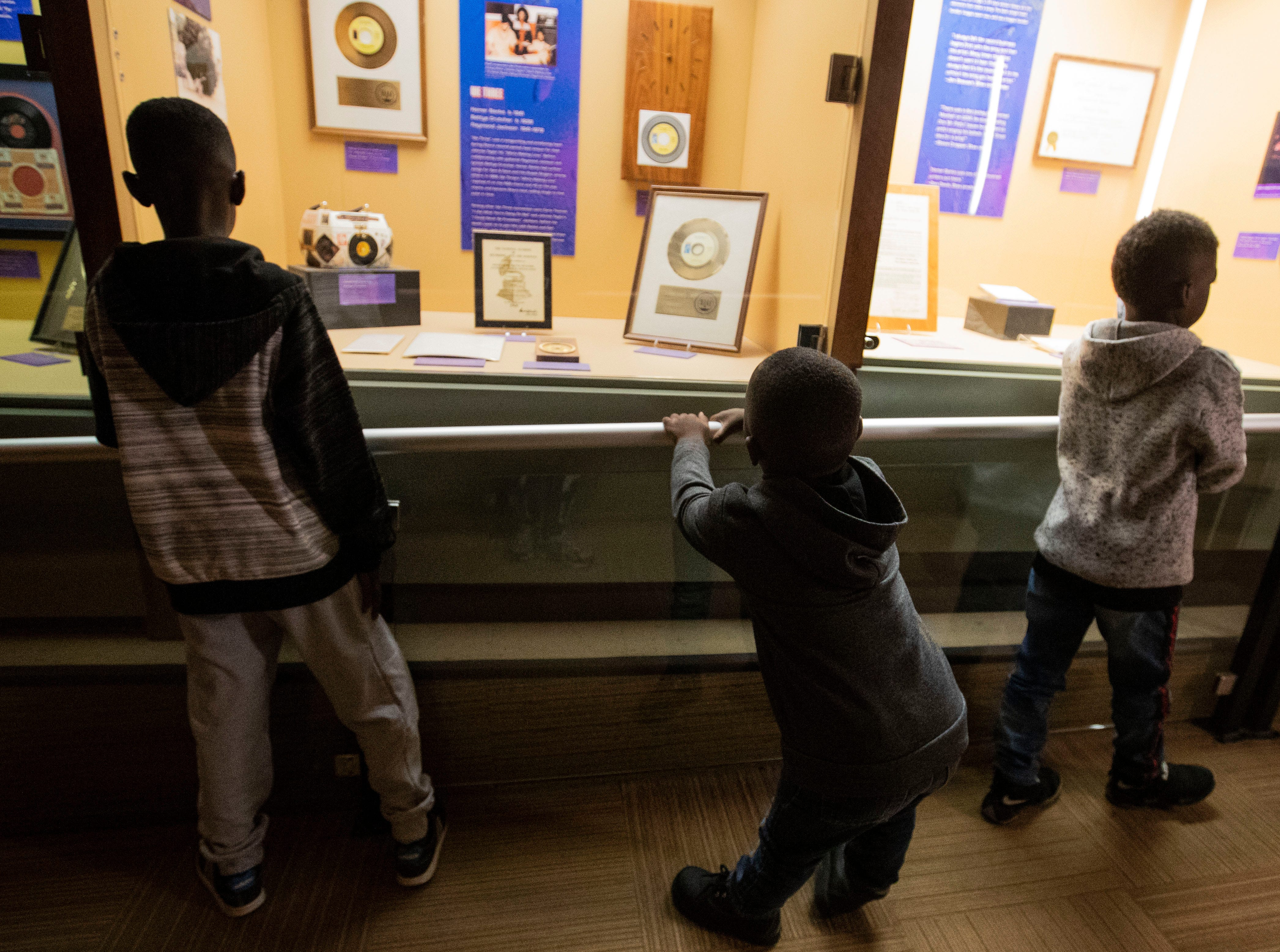 Brothers Jayden Jamar, Christian Hayes and Mason Hall view exhibits at the Stax Museum of American Soul Music during the 2018 Soulsville USA Festival Saturday October 20, 2018.