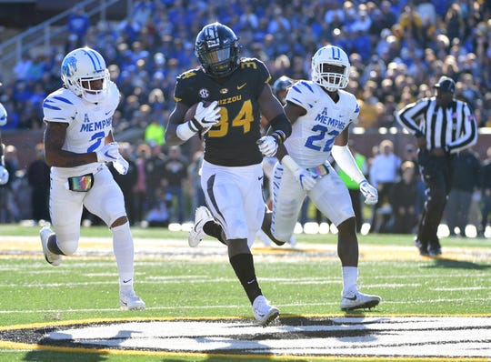 Oct 20, 2018; Columbia, MO, USA; Missouri Tigers running back Larry Rountree III (34) runs the ball as Memphis Tigers defensive back T.J. Carter (2) and defensive back Tyrez Lindsey (22) attempt the tackle during the first half at Memorial Stadium/Faurot Field.
