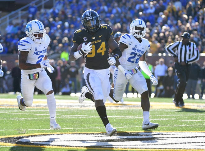 Memphis defensive back T.J. Carter (2) and defensive back Tyrez Lindsey (22) chase Missouri running back Larry Rountree III (34) during Saturday's game.