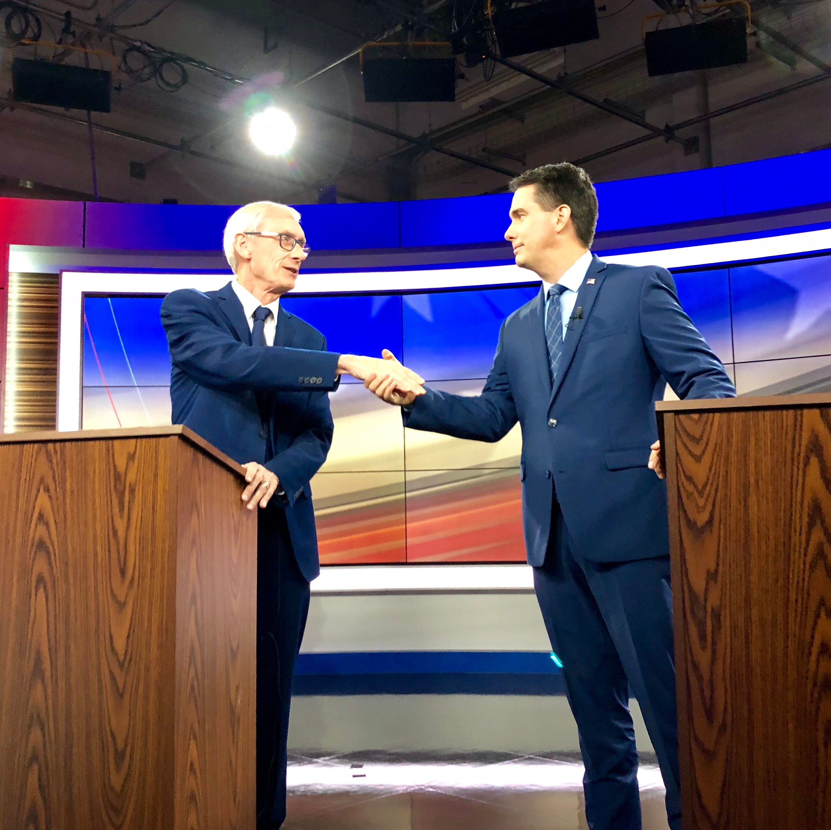 Scott Walker and Tony Evers spar over immigration, taxes, health care in first debate
