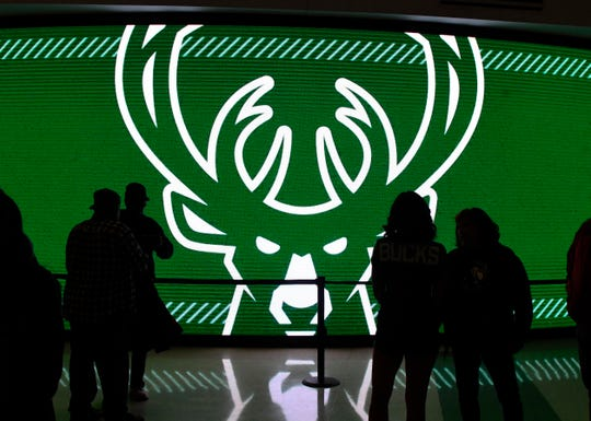The Bucks logo greets fans as they enter Fiserv Forum for the first ever regular-season game at the new downtown arena.