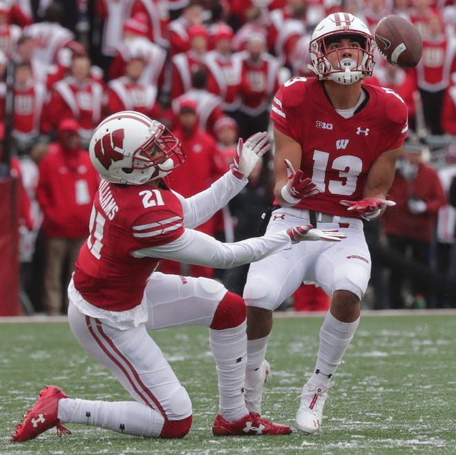 Wisconsin redshirt senior safety Evan Bondoc  intercepts a pass during the second quarter  Saturday.