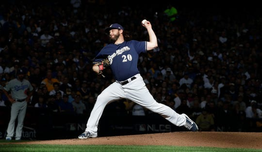 Milwaukee Brewers starting pitcher Wade Miley (20) has a strong outing during the Los Angeles Dodgers 4-3 win over the Milwaukee Brewers  in gamer two of  the  NLCS  in Milwaukee, Wisconsin, Saturday, October 13, 2018. RICK WOOD/MILWAUKEE JOURNAL SENTINEL ORG XMIT: 20096885B