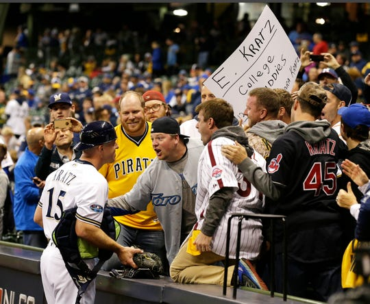 Milwaukee Brewers catcher Erik Kratz is greeted by his college friends before Game 6 of the National League Championship Series Oct. 19 at Miller Park.