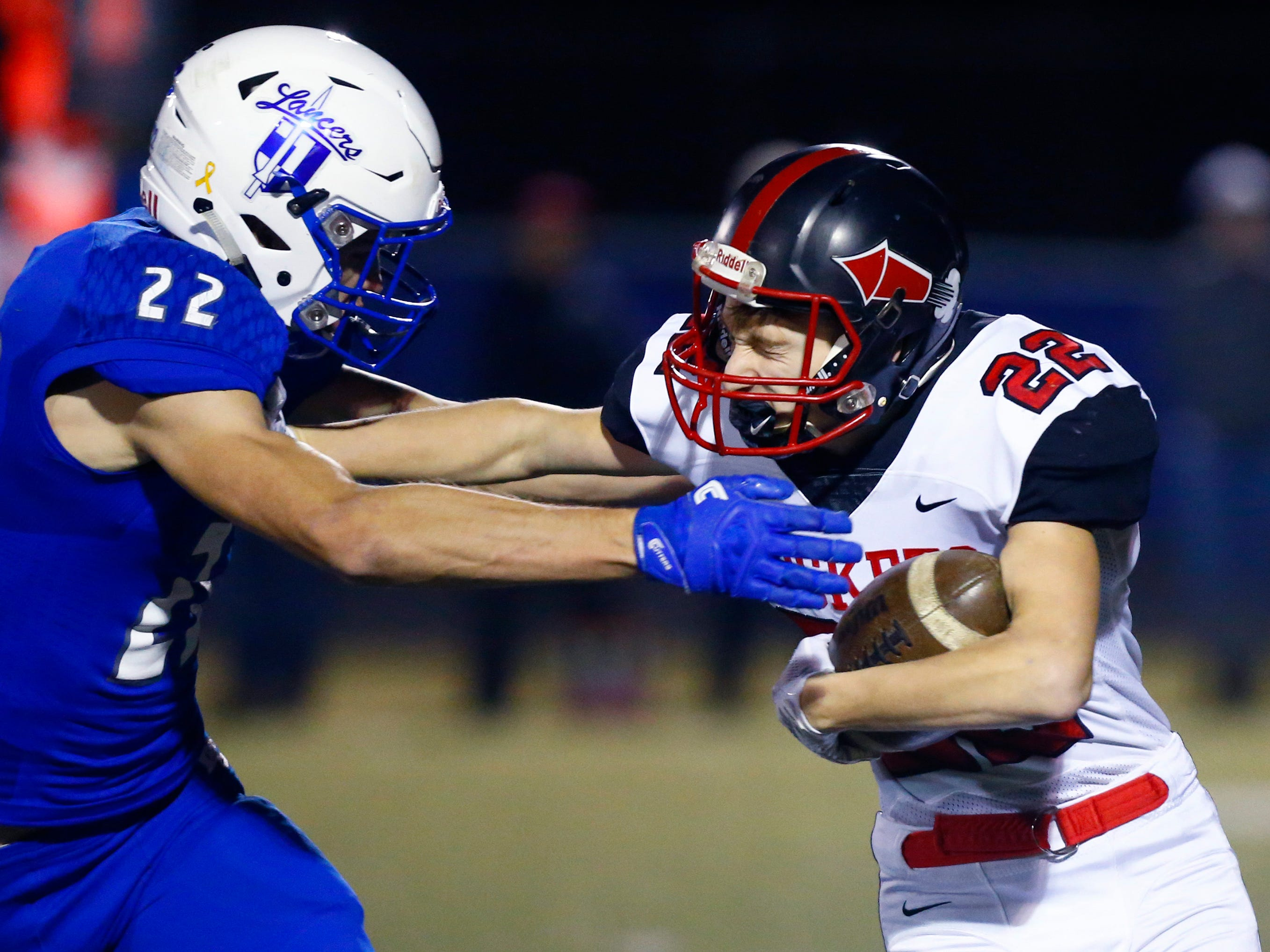 South Milwaukee's Broc Grenda strong arms Brookfield Central's Joey Cleary during a WIAA Division 2 playoff game at Central on Oct. 19.
