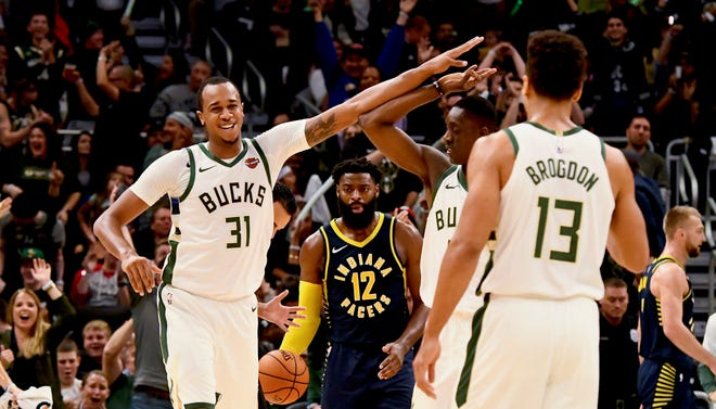 After going 1 of 13 from three-point distance in six seasons, John Henson made 11 of 31 (35.5 percent) during the first 14 games of this season