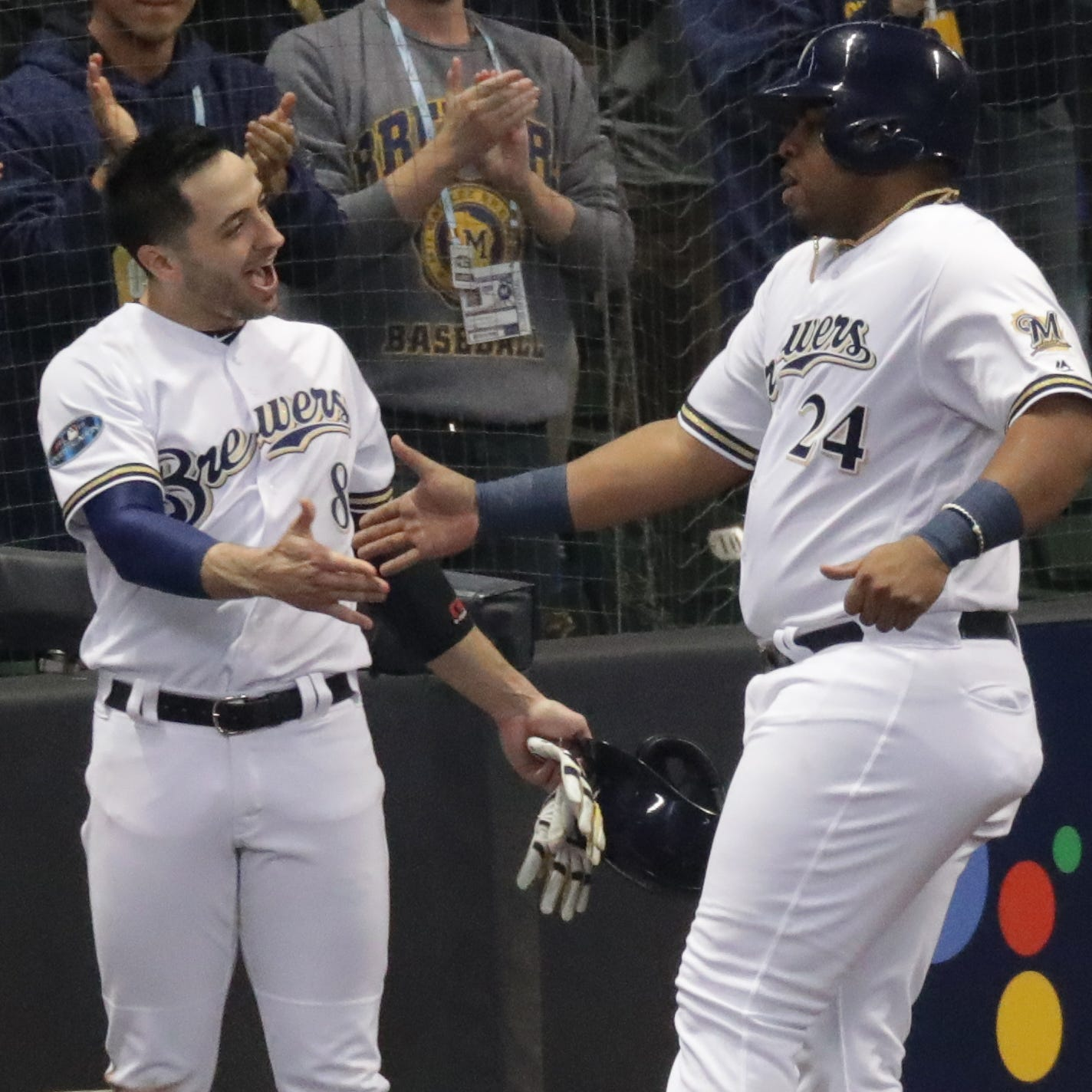 Brewers first baseman Jesus Aguilar is greeted by Ryan Braun after he scored in the first inning.