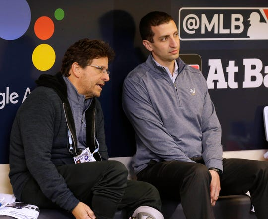 Brewers principal owner Mark Attanasio talks with general manager David Stearns before Game 6 of the 2018 NLCS. Attanasio give Stearns the additional title of president of baseball operations and promoted Rick Schlessinger from chief operating officer to president of business operations, the team announced Wednesday.