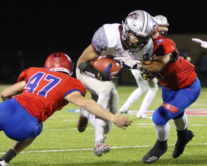 Menomonee Falls running back Julius Davis turned down offers from USC, Notre Dame and LSU to commit to the Badgers.
