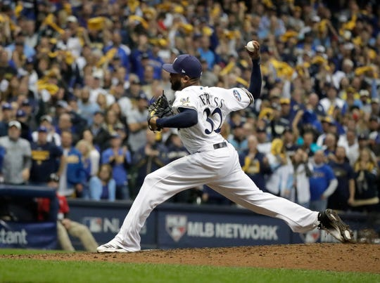 Brewers relief pitcher Jeremy Jeffress pitches the seventh inning.