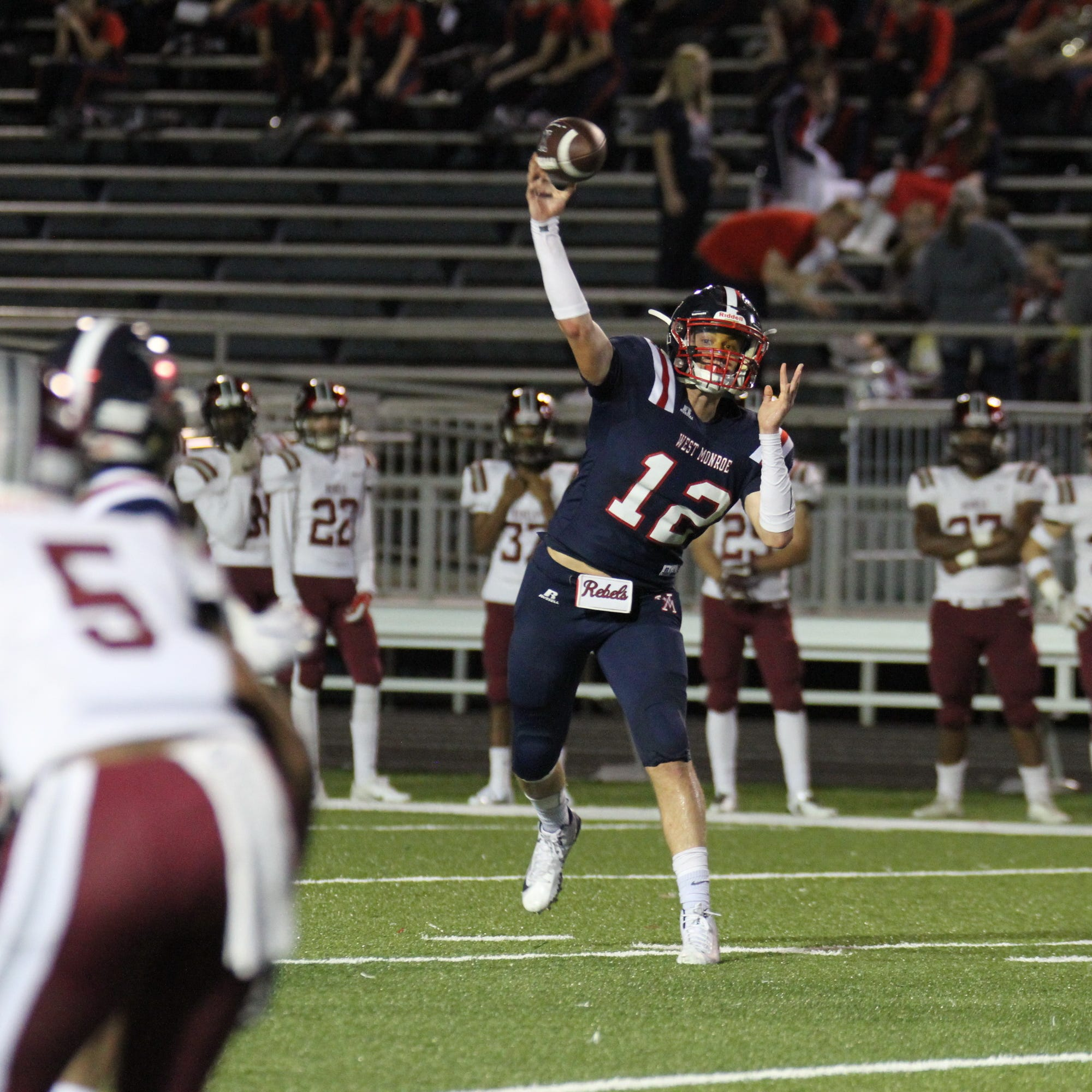 West Monroe junior quarterback Garrett Kahmann (12) rifles a pass against Pineville Friday, Oct. 19, 2018 at Rebel Stadium.