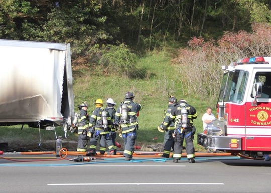 Accident scene on Route 80 west Friday afternoon in Rockaway, where a Jeep rear-ended a truck in the shoulder and was engulfed in flames. The Jeep driver was airlifted to Morristown, and later the burn unit at St Barnabas Medical Center. Oct. 20, 2018.