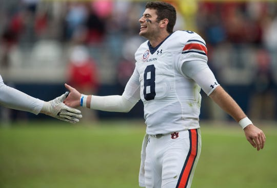 Auburn's Jarrett Stidham (8) high fives his team as they come off the field after a PAT at Vaught-Hemingway Stadium in Oxford, Miss., on Saturday, Oct. 20, 2018. Auburn defeated Ole Miss 31-16.