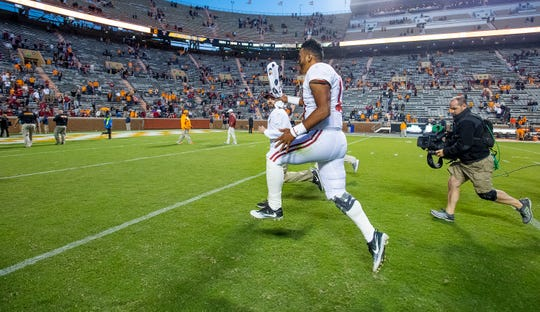 Alabama quarterback Tua Tagovailoa (13) skips and leaps as he runs off the field after defeating Tennessee at Neyland Stadium in Knoxville, Tn., on Saturday October 20, 2018.