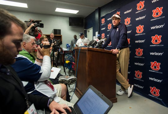 Auburn head coach Gus Malzahn talks with reporters during the post-game interview at Vaught-Hemingway Stadium in Oxford, Miss., on Saturday, Oct. 20, 2018. Auburn defeated Ole Miss 31-16.