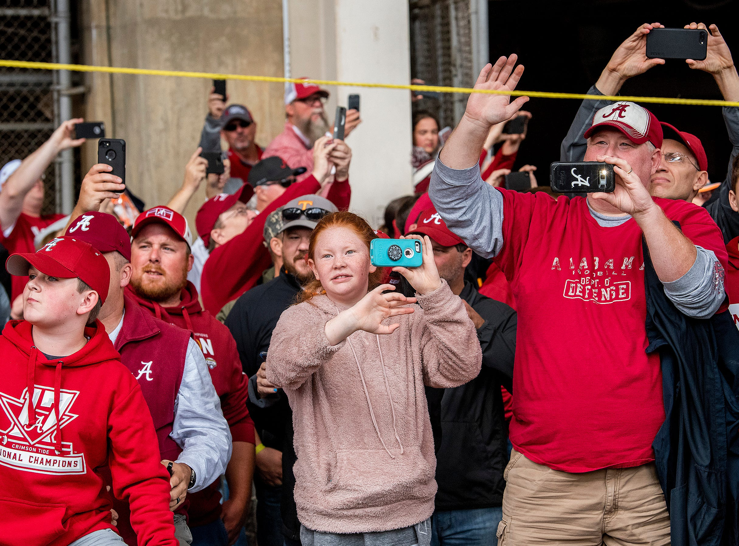 Alabama fans wave as Alabama arrives for the Tennessee game at Neyland Stadium in Knoxville, Tn., on Saturday October 20, 2018.