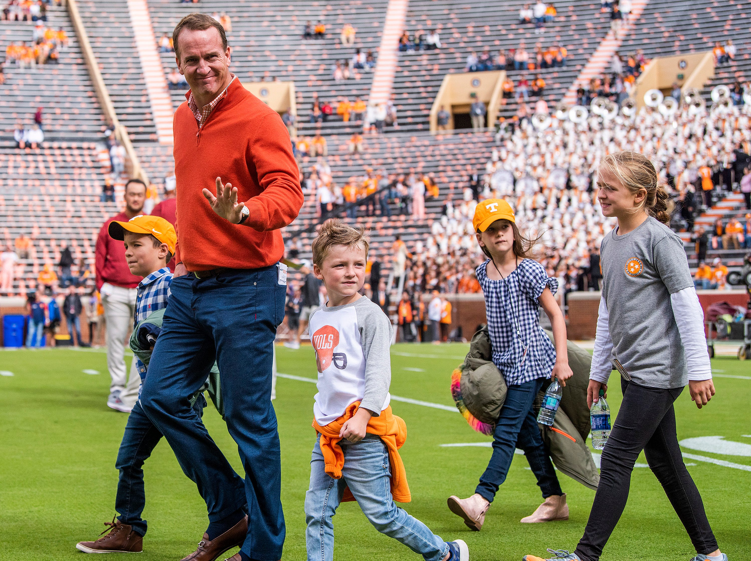 Payton Manning walks the field with his family before the Alabama vs. Tennessee game at Neyland Stadium in Knoxville, Tn., on Saturday October 20, 2018.