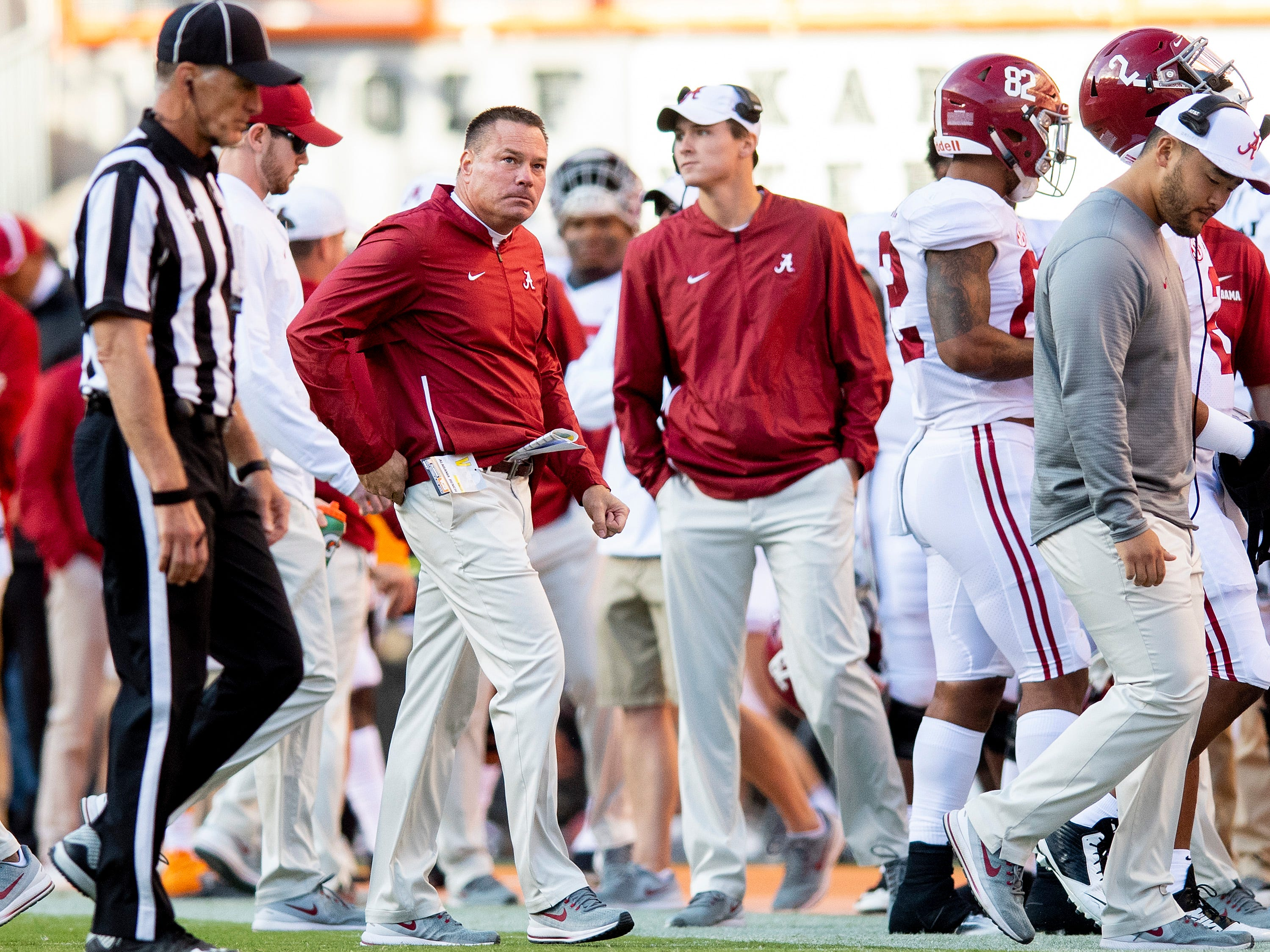 Alabama analyst Butch Jones works from the sidelines against Tennessee in first half action at Neyland Stadium in Knoxville, Tn., on Saturday October 20, 2018.