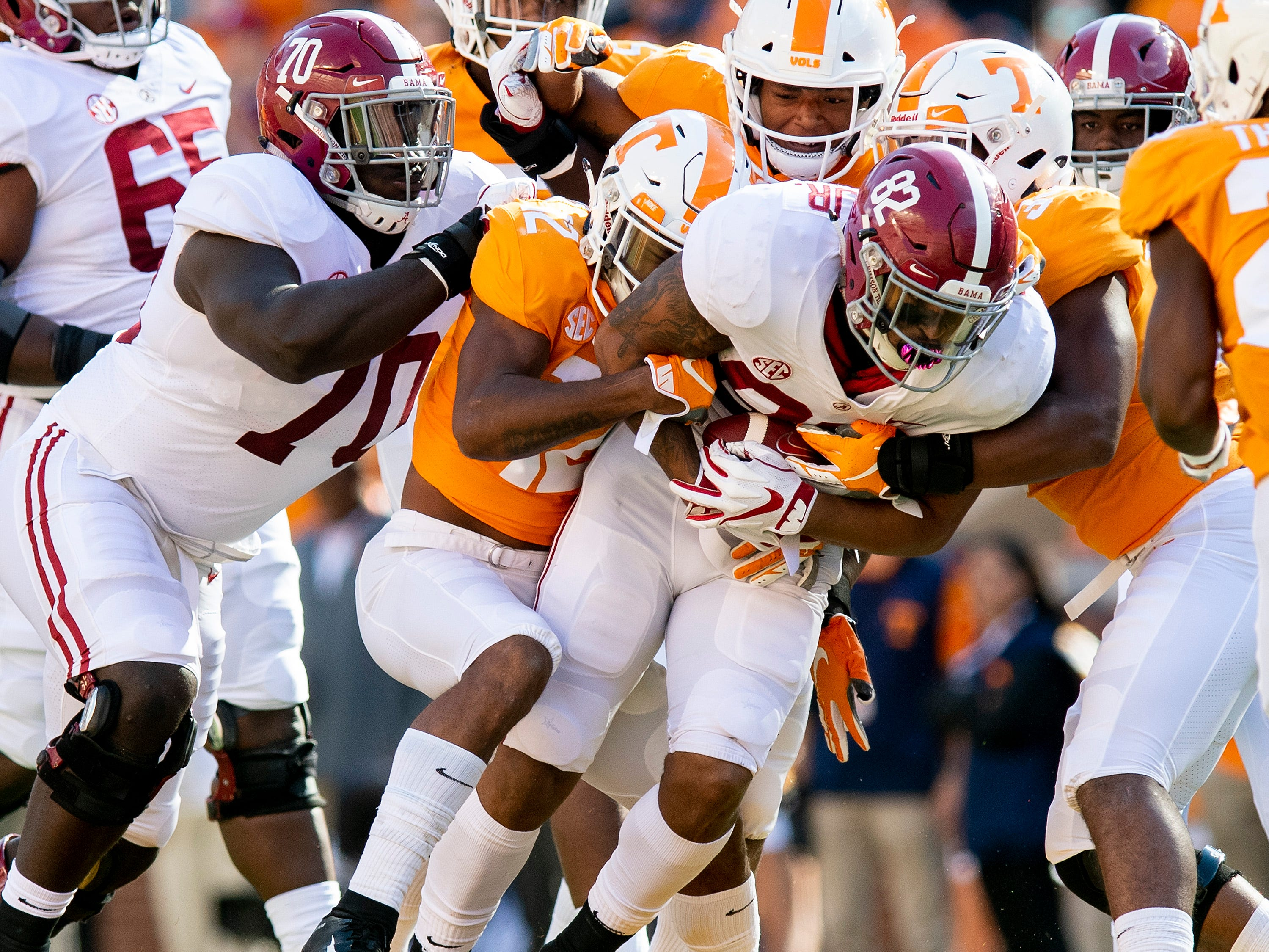 Alabama tight end Irv Smith Jr. (82) is gang tackled after a catch against Tennessee in first half action at Neyland Stadium in Knoxville, Tn., on Saturday October 20, 2018.