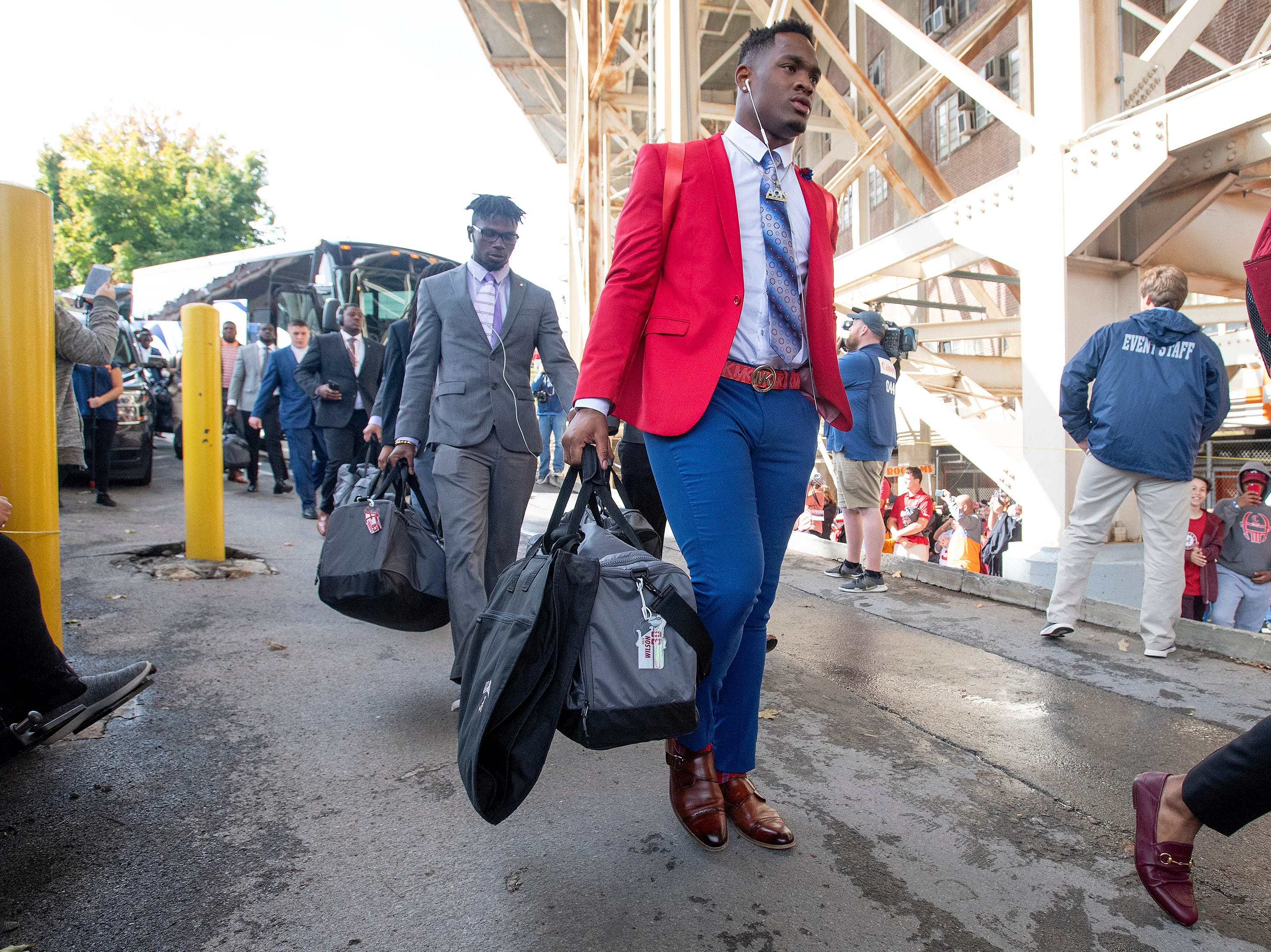 Alabama linebacker Mack Wilson (30) walks in as the team arrives for the Tennessee game at Neyland Stadium in Knoxville, Tn., on Saturday October 20, 2018.