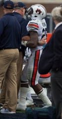 Auburn's JaTarvious Whitlow (28) limps to the sideline after suffering an injury on the field at Vaught-Hemingway Stadium in Oxford, Miss., on Saturday, Oct. 20, 2018. Auburn defeated Ole Miss 31-16.