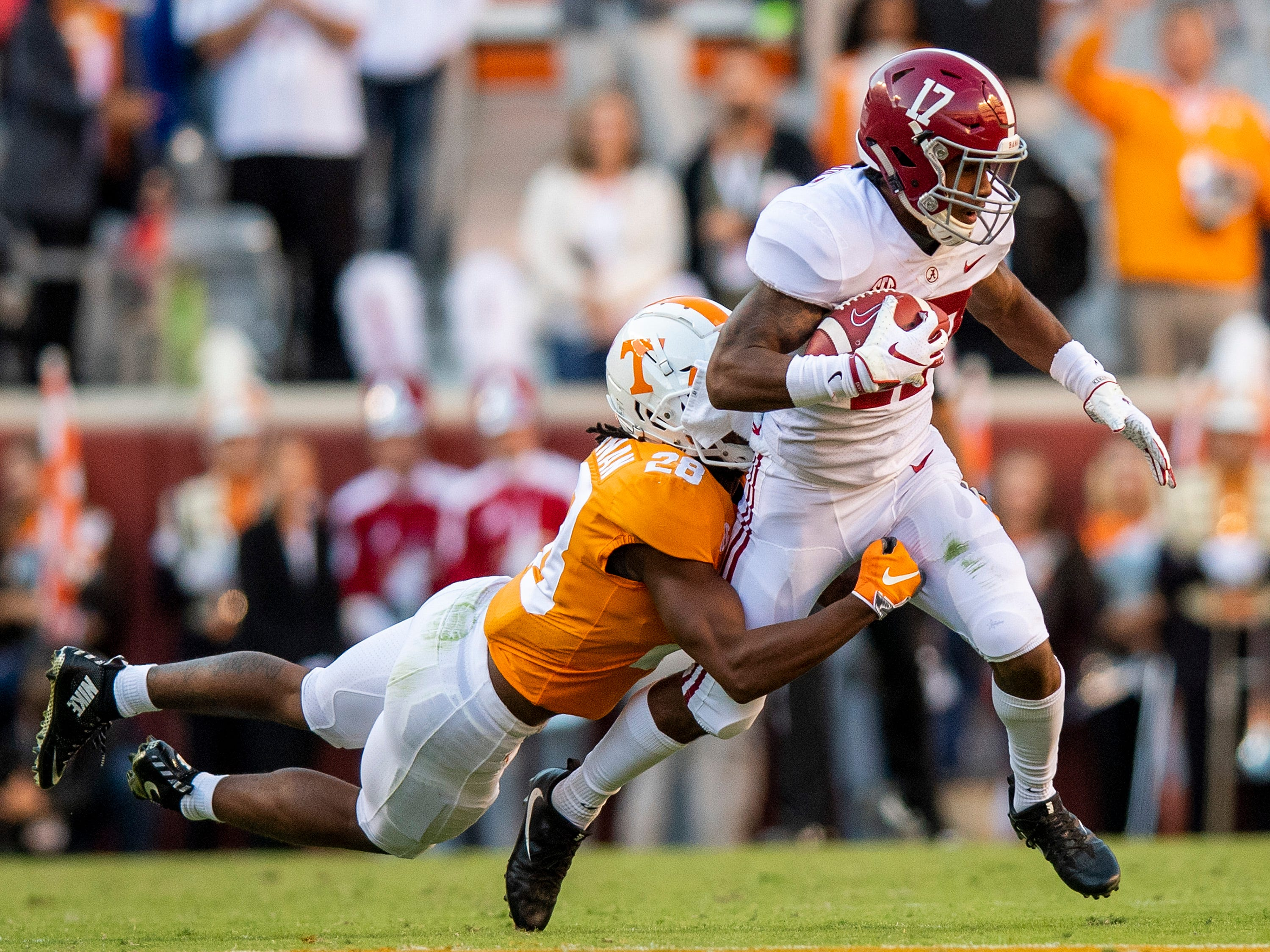 Alabama wide receiver Jaylen Waddle (17) tries to shake the tackle of Tennessee defensive back Baylen Buchanan (28) in first half action at Neyland Stadium in Knoxville, Tn., on Saturday October 20, 2018.