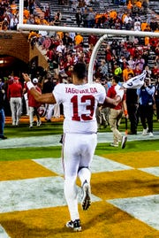 Alabama quarterback Tua Tagovailoa (13) runs off the field after defeating Tennessee in second half action at Neyland Stadium in Knoxville, Tn., on Saturday October 20, 2018.