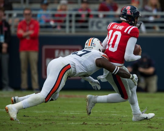 Ole Miss' Jordan Ta'amu (10) is tackled by Auburn's Deshaun Davis (57) at Vaught-Hemingway Stadium in Oxford, Miss., on Saturday, Oct. 20, 2018. Auburn leads Ole Miss 10-6 at halftime.