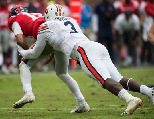 Auburn's Marlon Davidson (3) sacks Ole Miss' Jordan Ta'amu (10) at Vaught-Hemingway Stadium in Oxford, Miss., on Saturday, Oct. 20, 2018. Auburn defeated Ole Miss 31-16.