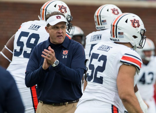 Auburn head coach Gus Malzahn cheers on his team as they warm up at Vaught-Hemingway Stadium in Oxford, Miss., on Saturday, Oct. 20, 2018.