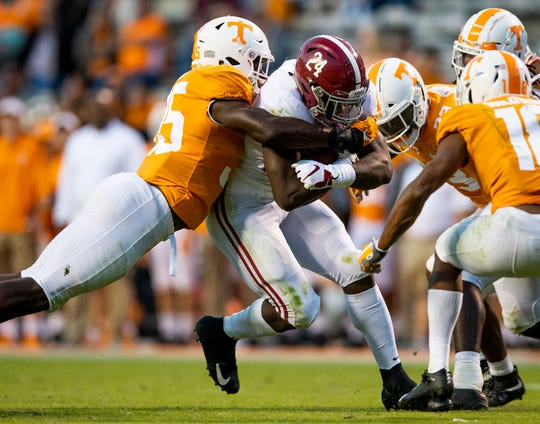 Alabama running back Brian Robinson Jr. (24) makes a first down on a fourth down play against Tennessee in second half action at Neyland Stadium in Knoxville, Tn., on Saturday October 20, 2018.