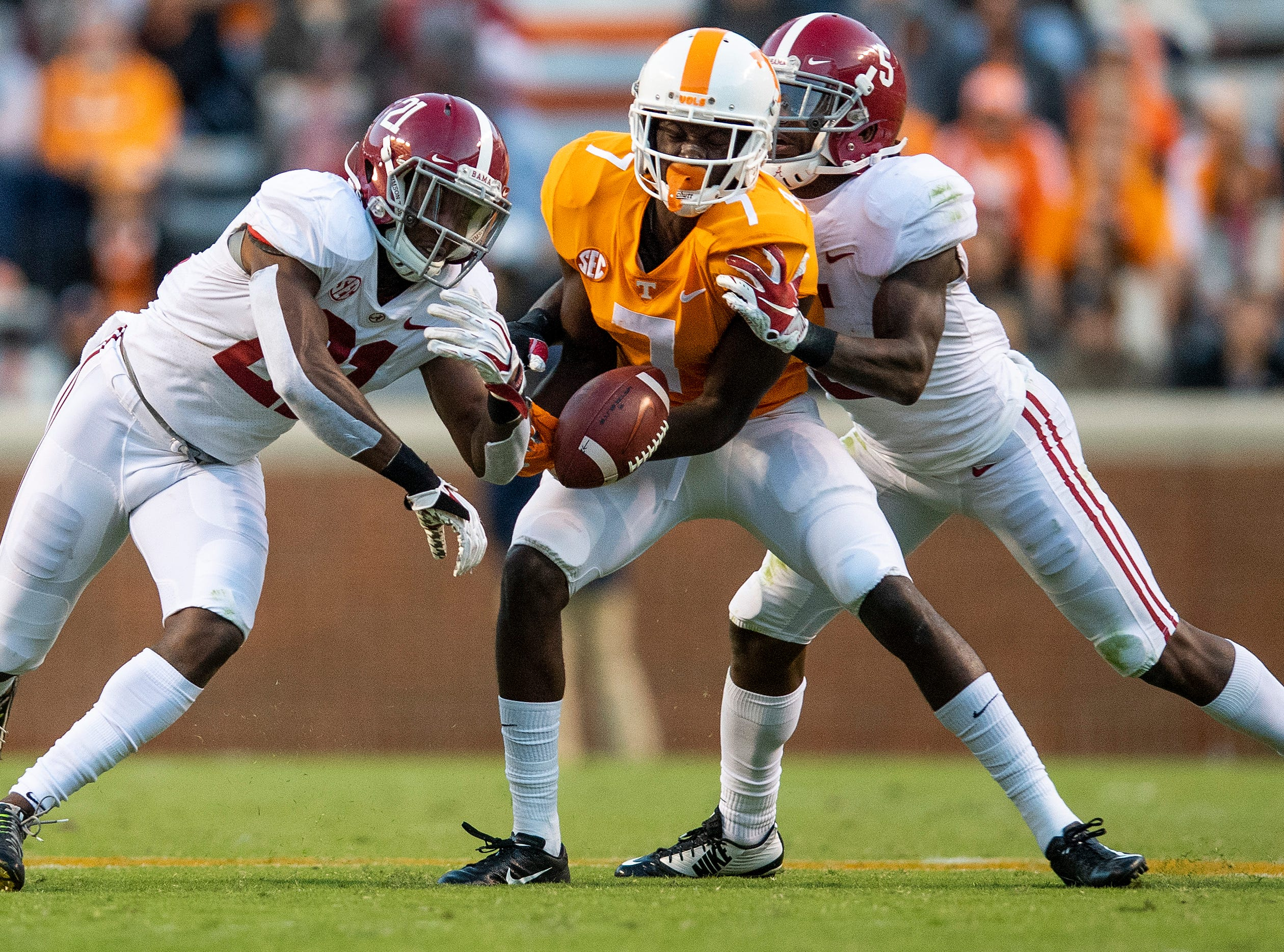 Alabama defensive back Jared Mayden (21) breaks up a pass intended for Tennessee wide receiver Brandon Edward Johnson (7) in second half action at Neyland Stadium in Knoxville, Tn., on Saturday October 20, 2018.