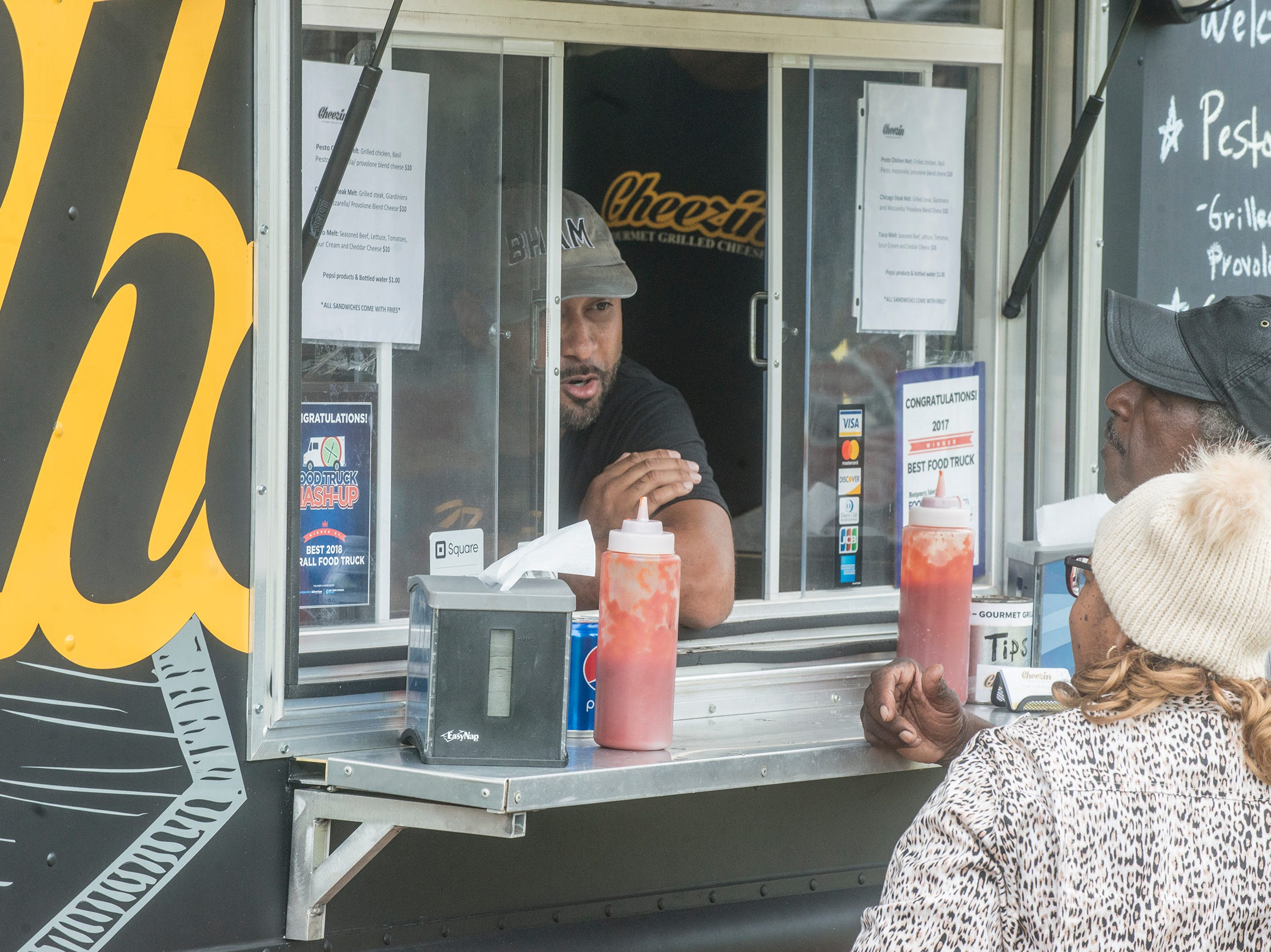 Guests visit Cheezin, the two-time champion of Food Truck Mash-Up. FTMU returned to Riverwalk Stadium on Saturday, Oct. 20, 2018, bringing a variety of food trucks, music and games for guests to enjoy.