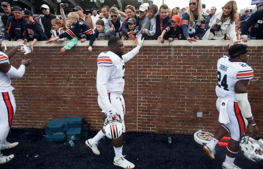 Auburn's Marlon Davidson (3) greets fans after the game at Vaught-Hemingway Stadium in Oxford, Miss., on Saturday, Oct. 20, 2018. Auburn defeated Ole Miss 31-16.