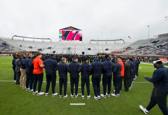 Auburn players huddle together at midfield at Vaught-Hemingway Stadium in Oxford, Miss., on Saturday, Oct. 20, 2018.