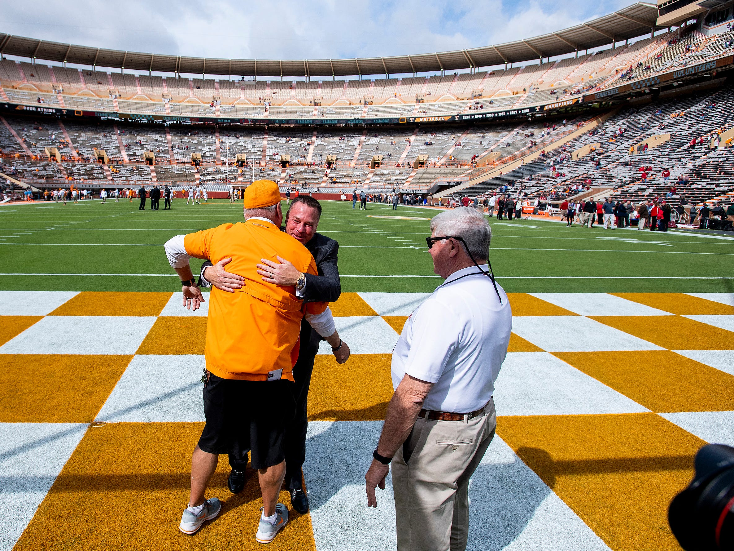 Alabama analyst Butch Jones hugs a friend as Alabama arrives for the Tennessee game at Neyland Stadium in Knoxville, Tn., on Saturday October 20, 2018.