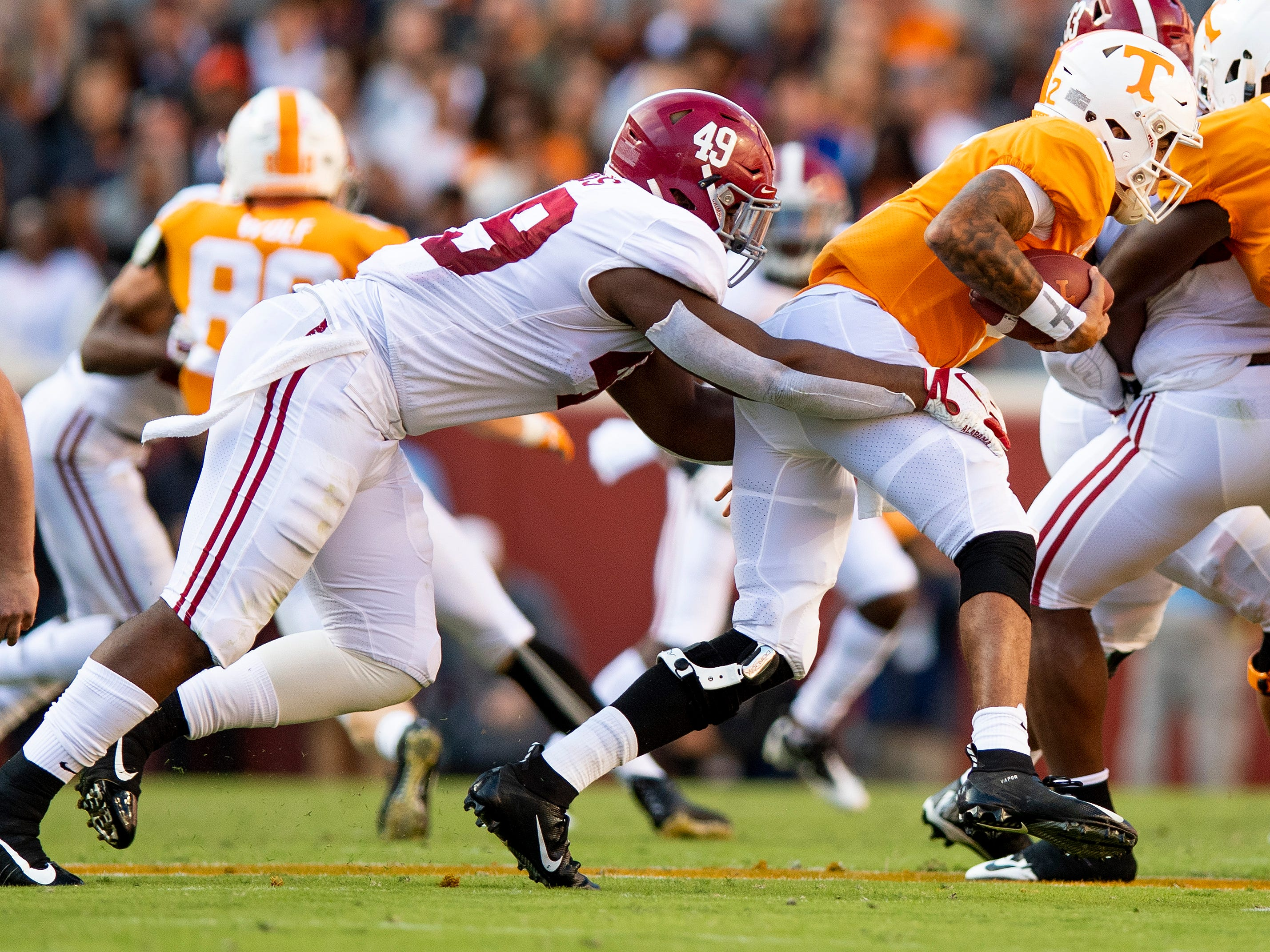 Alabama defensive lineman Isaiah Buggs (49) sacks Tennessee quarterback Jarrett Guarantano (2) in first half action at Neyland Stadium in Knoxville, Tn., on Saturday October 20, 2018.