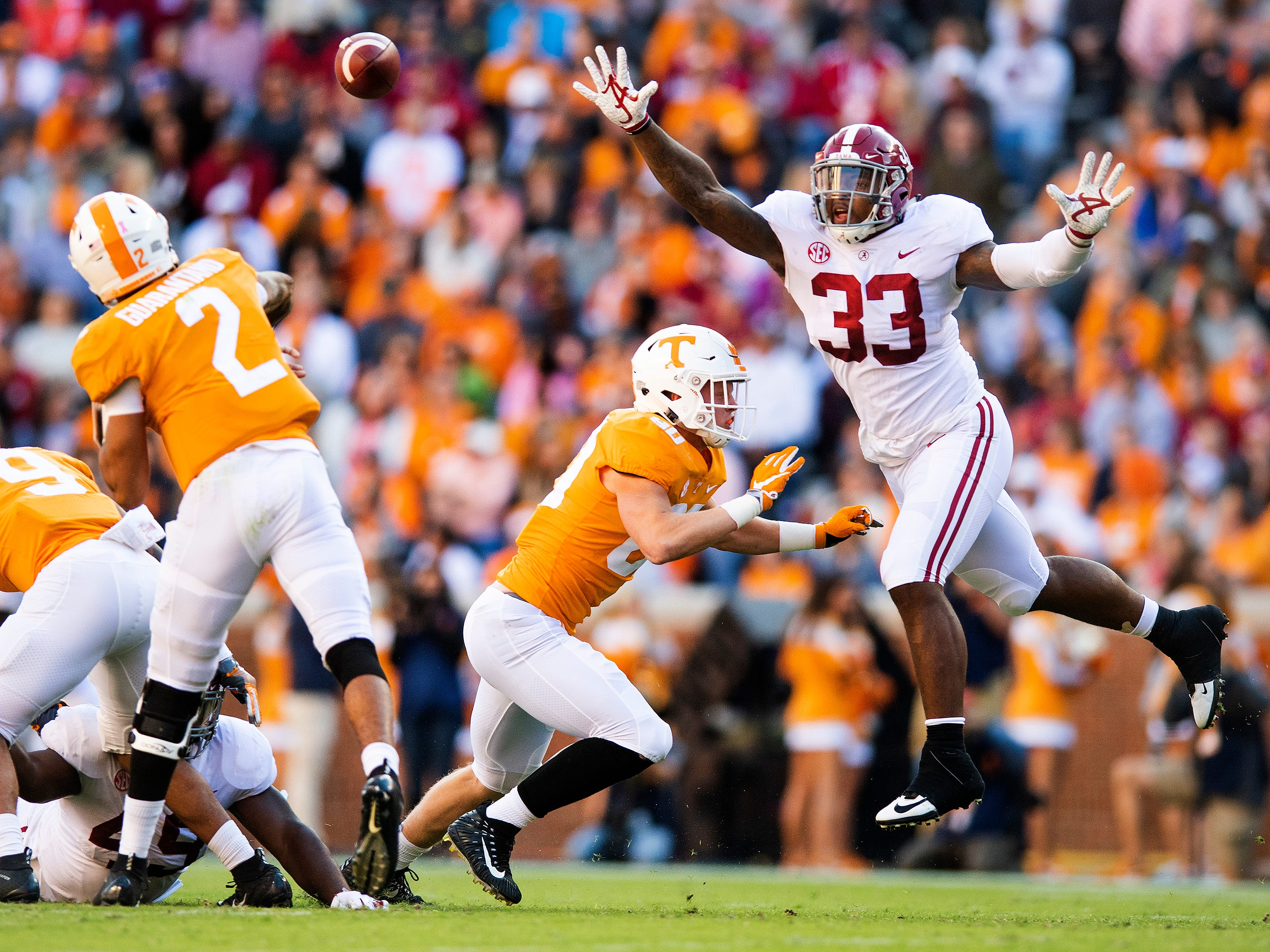 Alabama linebacker Anfernee Jennings (33) pressures Tennessee quarterback Jarrett Guarantano (2) in first half action at Neyland Stadium in Knoxville, Tn., on Saturday October 20, 2018.