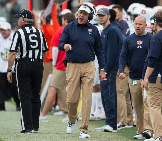 Auburn head coach Gus Malzahn yells on the sideline at Vaught-Hemingway Stadium in Oxford, Miss., on Saturday, Oct. 20, 2018. Auburn defeated Ole Miss 31-16.
