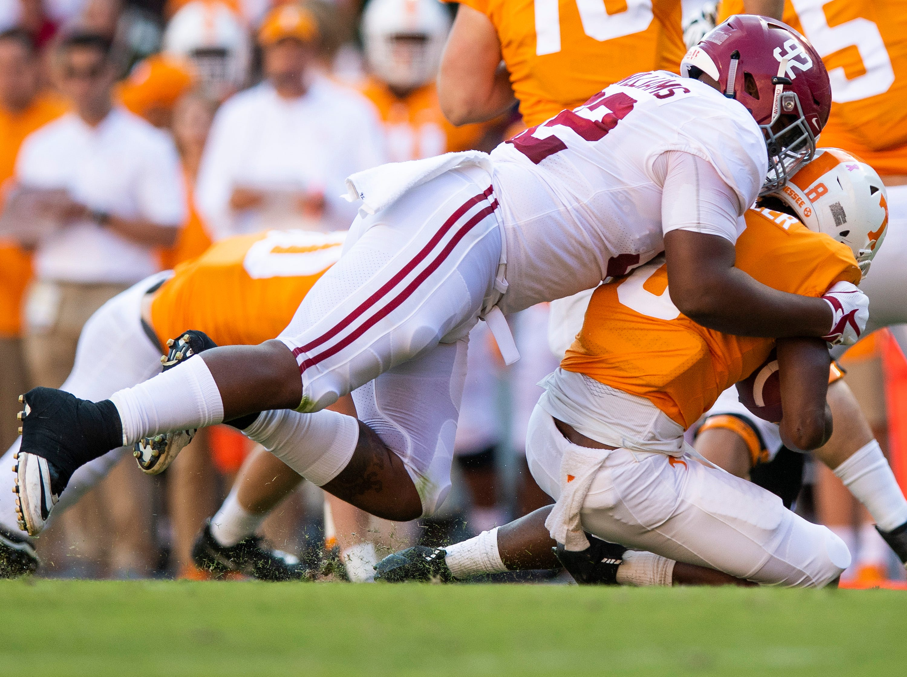 Alabama defensive lineman Quinnen Williams (92) stops Tennessee running back Ty Chandler (8)  for a loss in first half action at Neyland Stadium in Knoxville, Tn., on Saturday October 20, 2018.