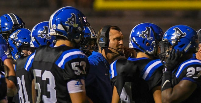Auburn head coach Adam Winegarden talks to the Tigers during the game against Prattville on Friday, Oct. 19, 2018, in Auburn.